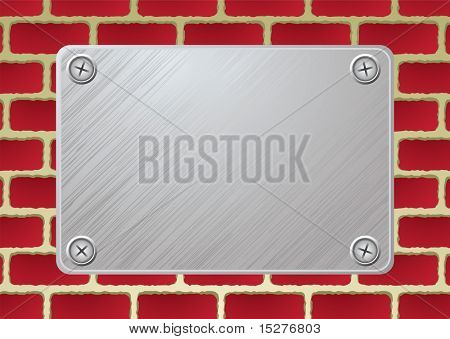 silver metal plate with screw on red brickwall