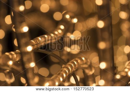Christmas lights background. Shiny orange golden light. Perfect for xmas footage.