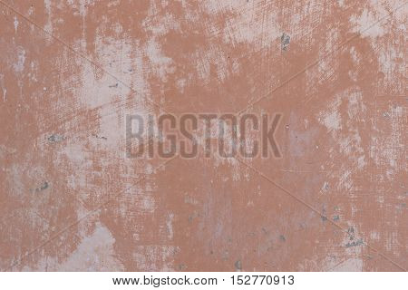 Image of a concrete wall in shades of brown suitable for use as a background or texture.
