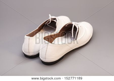 White Shoes isolated on a gray background