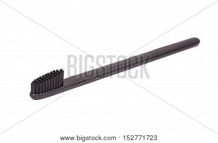 Black toothbrush isolated on a white background