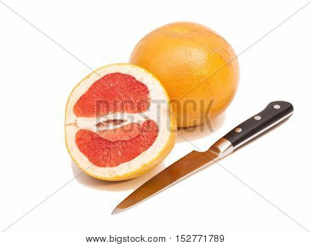 Knife and orange isolated on white background