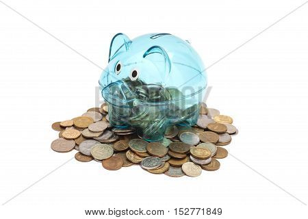 Glass Piggy Bank And Coins isolated on white