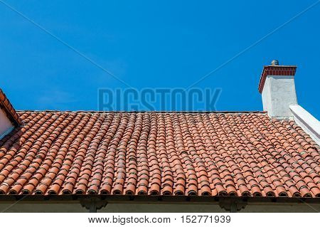 A red clay tile roof on a plaster hacienda