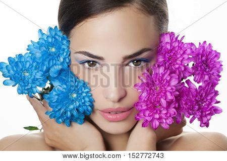 woman beauty portrait with blue and pink flowers studio white