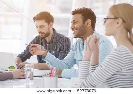 Correct solution. Creative business team working hard together in casual office