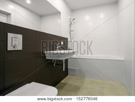 interior of a modern bathroom with shower and mixer