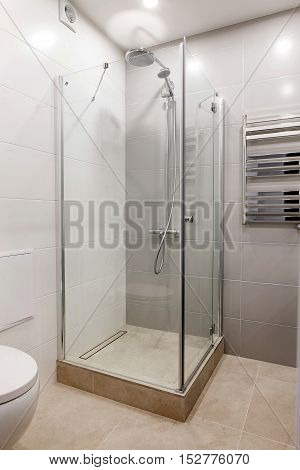 modern interior of a bathroom with shower and heater