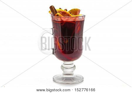 Irish mulled wine in glass with cinnamon stick and lemon with cloves