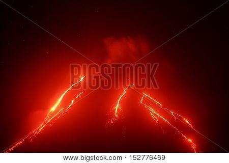 Volcanic landscape of Kamchatka Peninsula: night view of eruption Klyuchevskoy Volcano current lava flows on of volcano. Eurasia Russia Far East Kamchatka Klyuchevskaya Group of Volcanoes.