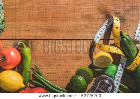Healthy food is the best diet. Vitamins near tape-measure on table