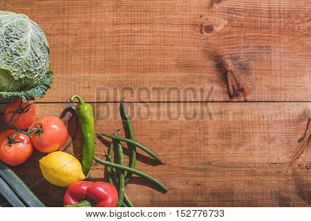 Close up top view of vegetables and fruits on wooden table
