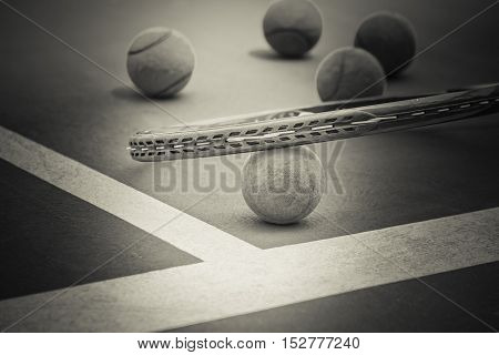 Tennis Ball with Racket on the clay tennis court black and white