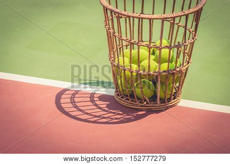 Tennis Ball with Racket on old basket tennis court