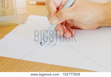 hand with pen marking check box check list for evaluation