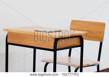 School classroom with school desks with chair on white background