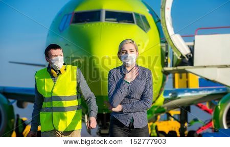 Sick traveling tourist at an airport with mask on the face