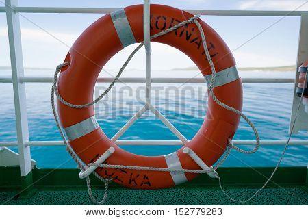 Zadar, Croatia - July 20, 2016: lifebuoy on the ferry Kornati -Jadrolinija ferry boat. Car ferry boats linking the islands to mainland