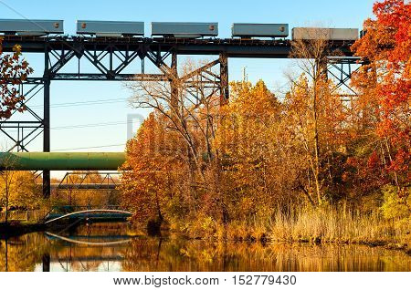 CUYAHOGA HEIGHTS OH - NOVEMBER 2 2015: A UPS freight train crosses a high trestle above the Ohio Canal south of Cleveland in late autumn.