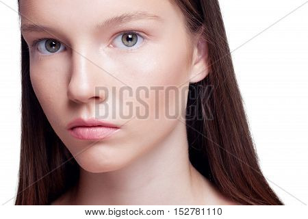 Beauty Woman face Portrait. Beautiful Spa model Girl with Perfect Fresh Clean Skin. brunette female looking at camera and smiling. Youth and Skin Care Concept. light background