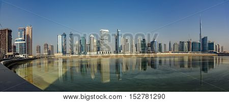 DUBAI, UAE - OCTOBER 13, 2016: A panorama of Dubai skyline in Business Bay showing the new Dubai Canal project with water flowing.  Water was released into the canal with opening expected next month