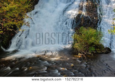 Nature waterfall in the forest water stream.