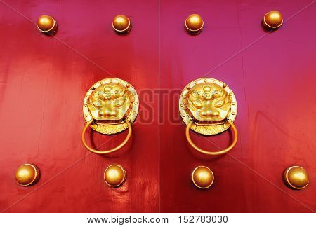 Chinese red gate doors with lion door knob Forbidden City Beijing