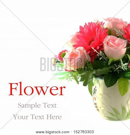 Multicolored flowers in a vase isolated on white background