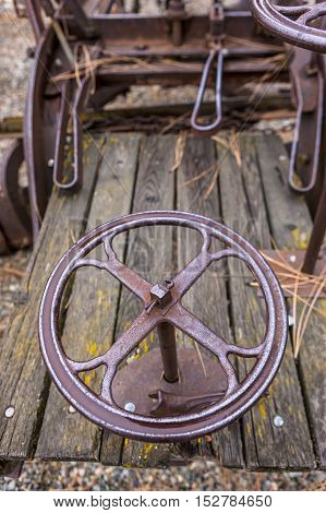 An old wheel on an antique machine at a museum in Winthrop Washington.
