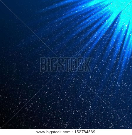 Shiny sunburst of sunbeams on the star sky. Blue rays of the sun on a background of the starry sky. Glare.