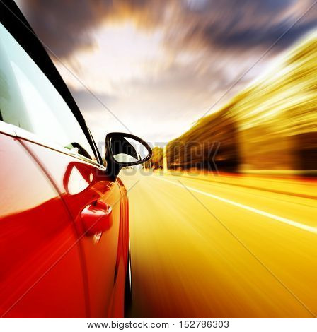 A car driving on a motorway at high speeds overtaking other cars
