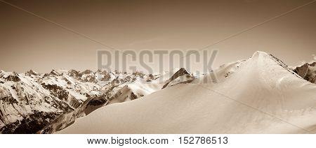 Panoramic View On Winter Snow Mountain