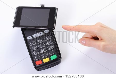 Hand Of Woman Showing Payment Terminal With Mobile Phone With Nfc Technology