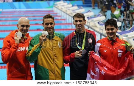 RIO DE JANEIRO, BRAZIL - AUGUST 12, 2016: Laszlo Cseh HUN (L), Chad le Clos RSA , Michael Phelps USA and Joseph Schooling SGP during medal ceremony after Men's 100m butterfly of the Rio 2016 Olympics