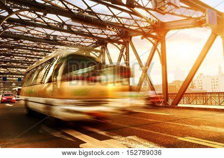 The car quickly crossed the bridge in Shanghai.
