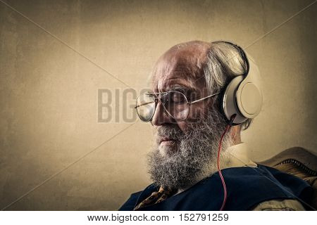 Elderly man wearing headphones