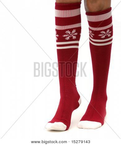 Legs in Christmas stockings, isolated.