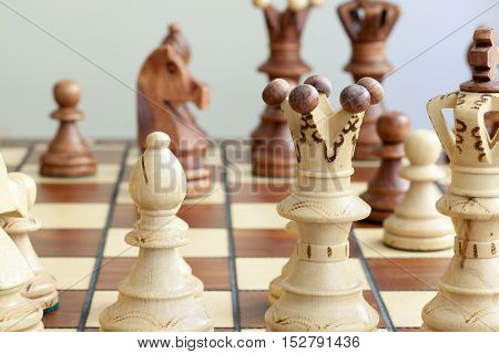 closeup of the chess pieces on chessboard