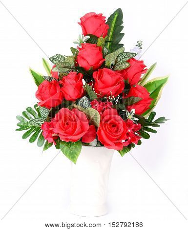 A beautiful bouquet of red flowers in vase on isolated white background.