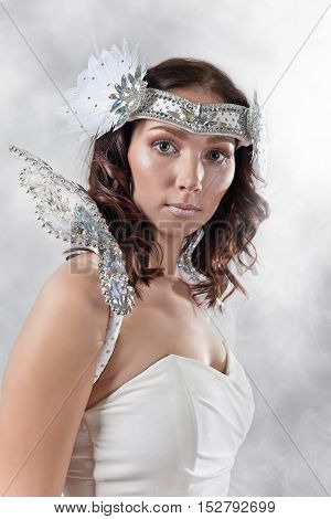 Young Beautiful Woman In Angel Costume