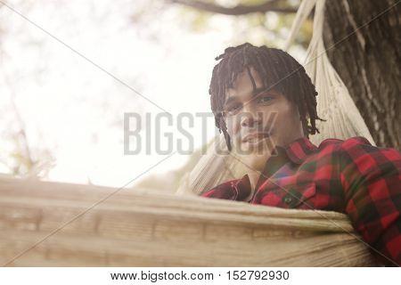 Relaxed guy lying in a hammock