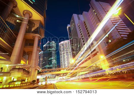 Road Light Trails On Modern City Buildings Backgrounds In Hongkong
