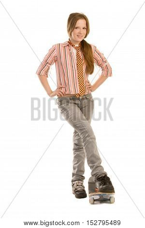 Teenage girl is standing by the skateboard isolated on white background