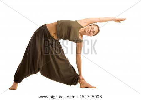Woman in oriental pants doing yoga isolated on white