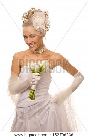 Beautiful cheerful bride with the bouquet made of calla Lily
