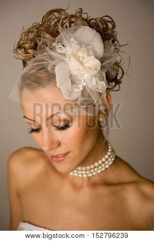 Close up of young sensual bride with modern hairstyle