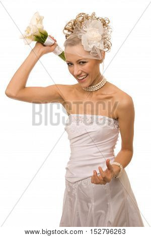 Cheerful bride is throwing the bouquet made of calla Lily