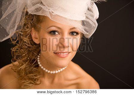 Retro bride portrait close up on the black background