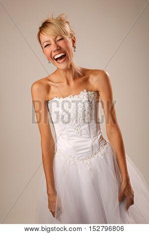 Happy bride is standing and screaming. Studio shoot