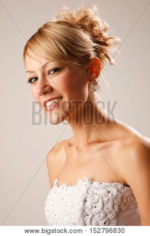 Portrait of a gourgeus shining bride with modern hairstyle